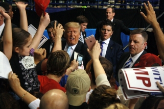 Donald Trump reacts to a crowd of supporters seeking autographs after a campaign rally in Fayetteville, N.C. on March 9, 2016.